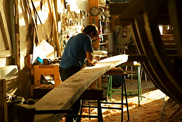 Rear view of a carpenter working in a workshop, Spain
