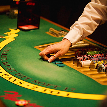 High angle view of a casino dealer dealing at a table, Las Vegas, Nevada, USA