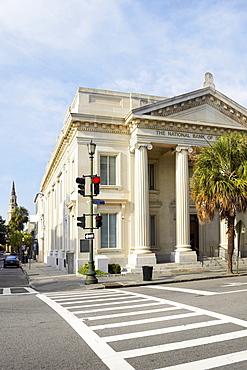 Palm tree in front of a bank, National Bank of South Carolina, Charleston, South Carolina, USA