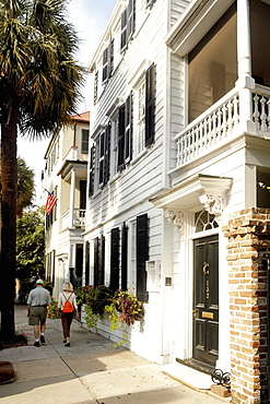 Rear view of a man and a woman walking on the street, Charleston, South Carolina, USA