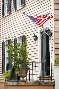 American flag fluttering on the entrance of a building, Savannah, Georgia, USA