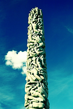 Low angle view of sculptures carved on a column, Gustav Vigeland Sculpture Park, Oslo, Norway