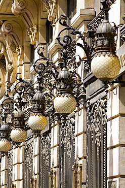 Lanterns on a building, Madrid, Spain