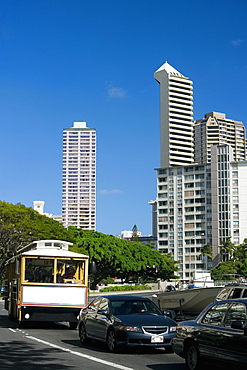 Traffic on the road with skyscrapers in the background, Honolulu, Oahu, Hawaii Islands, USA