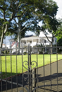 Close-up of a wrought iron gate with a building in the background, Honolulu, Oahu, Hawaii Islands, USA