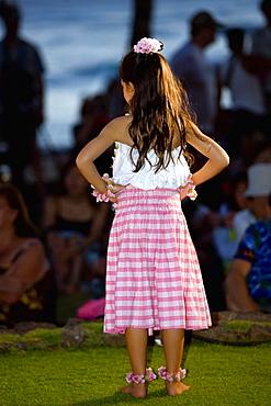 Rear view of a girl standing on the beach, Waikiki Beach, Honolulu, Oahu, Hawaii Islands, USA
