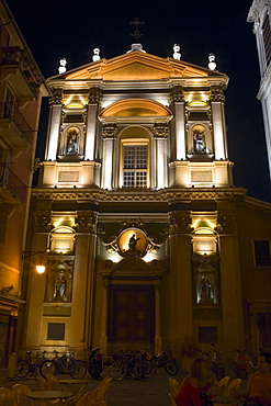 Low angle view of a restaurant lit up at night, Nice, France