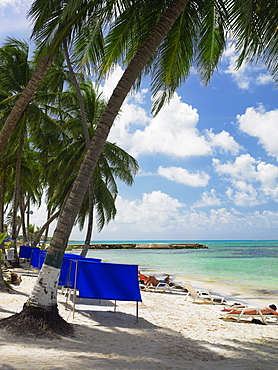 Tourists sunbathing on the beach, Spratt Bight Beach, San Andres, Providencia y Santa Catalina, San Andres y Providencia Department, Colombia