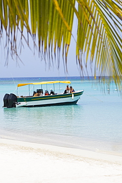 Tourists traveling in a tourboat in the sea, Honduras
