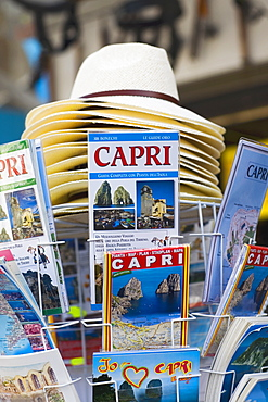 Magazines and sun hats at a market stall, Capri, Campania, Italy