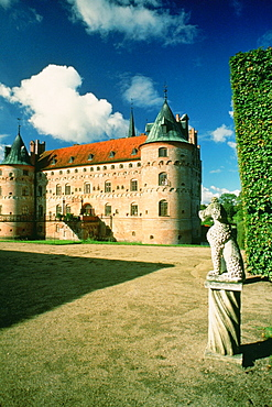 Statue in the courtyard of a castle, Egeskov Castle, Funen County, Denmark