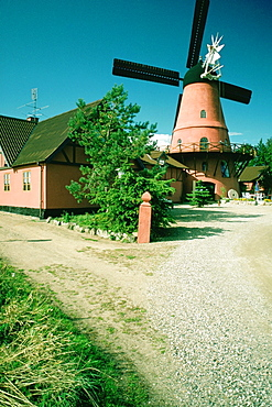 Windmill and a restaurant on a country road, Funen County, Denmark