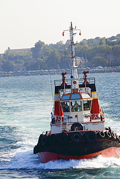 Tugboat moving in a river, Athens, Greece