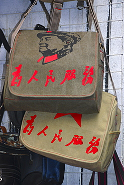 Close-up of bags hanging on a grille, Beijing, China
