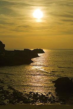 Silhouette of rocks in the ocean, Baie de Biarritz, Biarritz, France