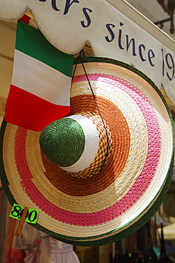 Sun hat hanging at a market stall, Sorrento, Sorrentine Peninsula, Naples Province, Campania, Italy