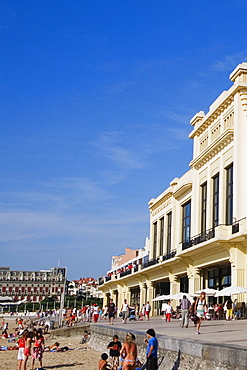 Group of people in front of a hotel, Casino Municipal, Hotel Du Palais, Grande Plage, Biarritz, France
