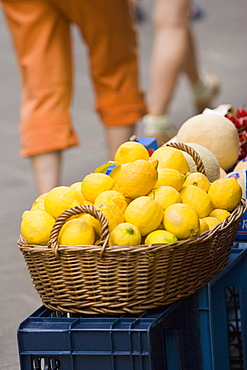 Close-up of lemons in a wicker basket at a market stall, Italian Riviera, Cinque Terre National Park, Vernazza, La Spezia, Liguria, Italy