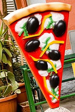 Pizza sculpture in front of a restaurant, Parco Nazionale delle Cinque Terre, Manarola, La Spezia, Italy