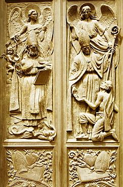 Bas relief on the door of a church, Chiesa Di Nostra Signora Della Consolazione, Genoa, Liguria, Italy