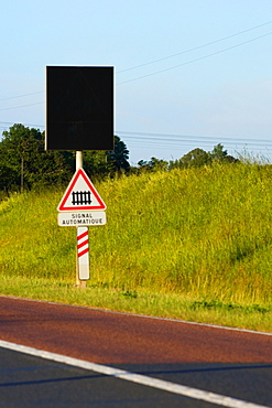 Railroad crossing signboard at the roadside, Loire Valley, France