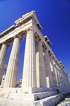 Low angle view of old ruin colonnades in a shrine, Parthenon, Athens, Greece