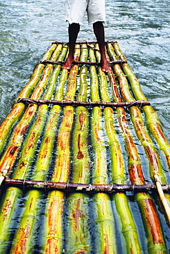 A bamboo raft is seen floating down the Martha Brae River, Jamaica