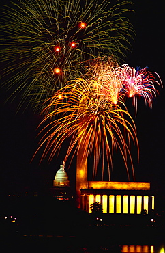 Low angle view of fire works display at night, Lincoln Memorial, Washington Monument, Washington DC, USA