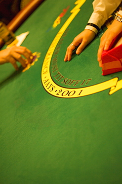 High angle view of person's hand on a gaming table, Las Vegas, Nevada, USA