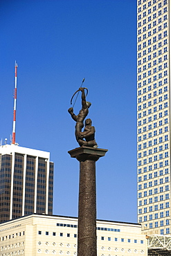 Low angle view of a statue in front of buildings in a city, Miami, Florida, USA