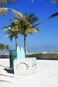 Garbage bin near a bench, Miami, Florida, USA