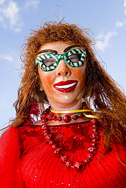 Low angle view of a woman wearing a carnival mask