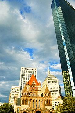 Low angle view of buildings in a city, Trinity Church, John Hancock Tower, Boston, Massachusetts, USA