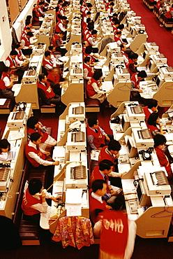 High angle view of businessmen and businesswomen working at a stock exchange, Hong Kong, China