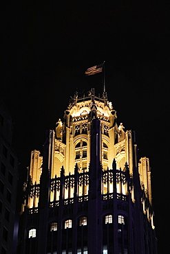 Low angle view of tower at night, Tribune Tower, Chicago, Illinois, USA