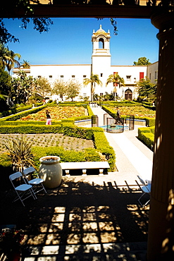 Panoramic view of the facade of an ethnic building, Alcazar Garden, Balboa Park, San Diego, California, USA