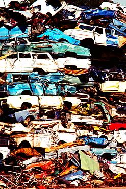 Close-up of a heap of cars in a junkyard