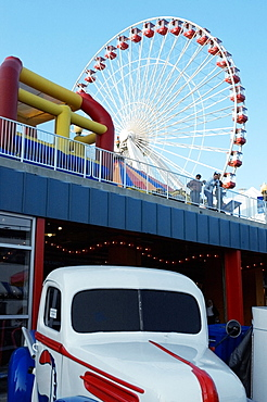Low angle view of a ferris wheel in an amusement park