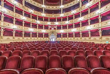 Interior of the Teatro Verdi, red velvet seats in the auditorium, Trieste, Italy.