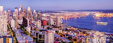 Seattle cityscape and coastline at dusk