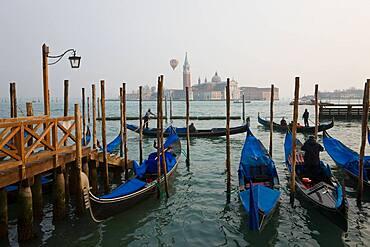 Venice, Gondolas moored at Piazza San Marco, view to San Giorgio Maggiore, Venice, Italy