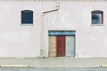 Old building with closed doors on Main Street in a town