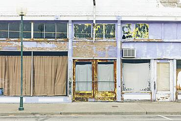 Main Street with boarded up windows, closed business