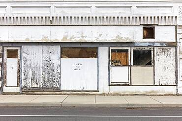 Abandoned storefronts and buildings on a deserted main street