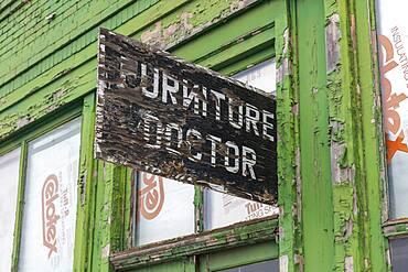Abandoned business, Furniture Doctor sign above front door