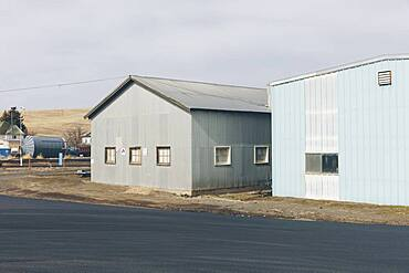 Agricultural storage buildings by a road
