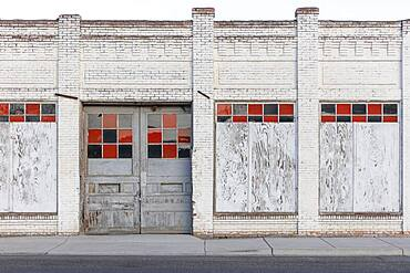 A boarded up building, a closed business on Main Street.