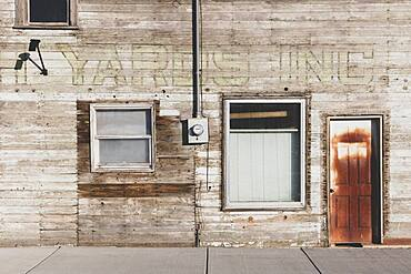 Old wooden building on Main Street, boarded up windows.