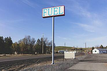 Fuel sign for rural gas station in a small town.