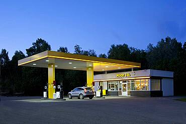 Gas station, petrol station on a road at dusk.